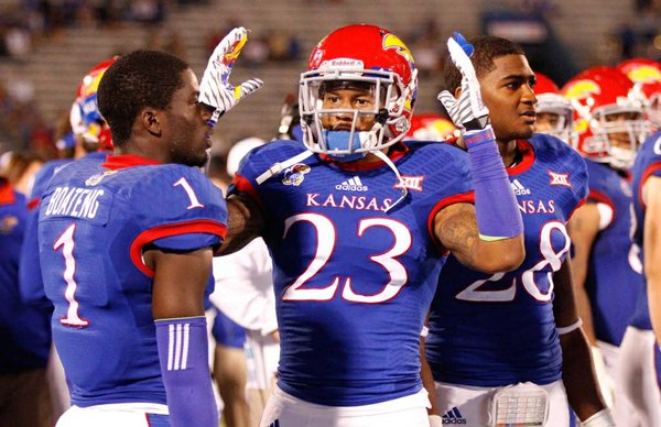 Kansas defenders Matthew Boateng, Ronnie Davis and Courtney Arnick react to a late touchdown catch by Southeast Missouri State during the fourth quarter on Saturday, Sept. 6, 2014 at Memorial Stadium.