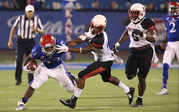 Kansas running back De'Andre Mann escapes a Southeast Missouri State defender during a run in the fourth quarter on Saturday, Sept. 6, 2014 at Memorial Stadium.