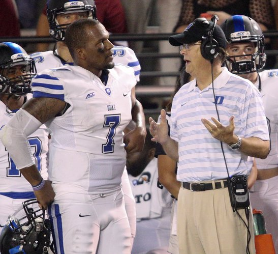 Duke Head Coach David Cutcliffe talks with quarterback Anthony Boone (7) in the second half of an NCAA college football game at Veterans Memorial Stadium, Saturday, Sept. 6, 2014, in Troy, Ala. (AP Photo/ Hal Yeager)