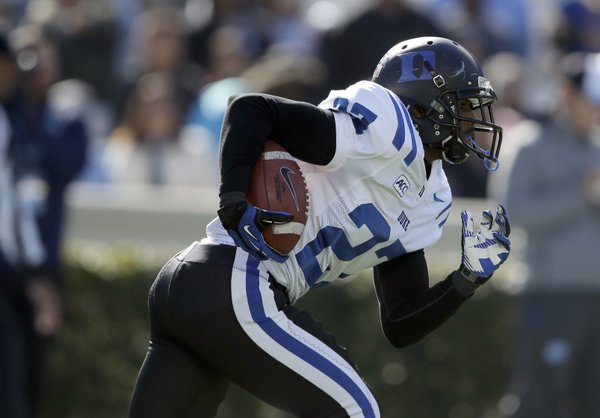 Duke's DeVon Edwards (27) runs against North Carolina during the first half of an NCAA college football game in Chapel Hill, N.C., Saturday, Nov. 30, 2013. (AP Photo/Gerry Broome)
