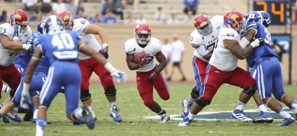 Kansas running back De'Andre Mann finds a hole against Duke during the second quarter on Saturday, Sept. 13, 2013 at Wallace Wade Stadium in Durham, North Carolina.