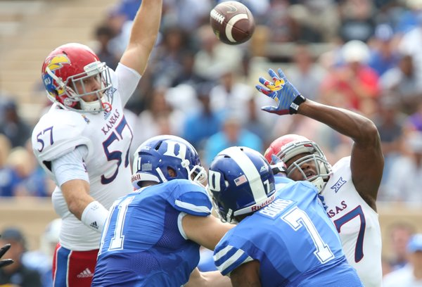 Kansas defenders Jake Love (57) and Victor Simmons can't stop a throw from Duke quarterback Anthony Boone during the first quarter on Saturday, Sept. 13, 2013 at Wallace Wade Stadium in Durham, North Carolina.
