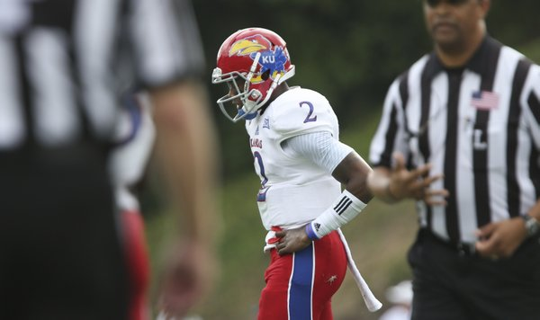 Kansas quarterback Montell Cozart reacts after a turnover on downs by the Jayhawks against Duke during the first quarter on Saturday, Sept. 13, 2013 at Wallace Wade Stadium in Durham, North Carolina.