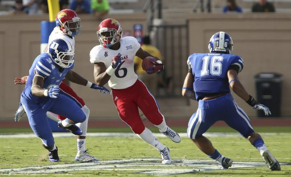 Kansas running back Corey Avery cuts between Duke defenders Jonathan Jones (34) and Jeremy Cash during the third quarter on Saturday, Sept. 13, 2013 at Wallace Wade Stadium in Durham, North Carolina.