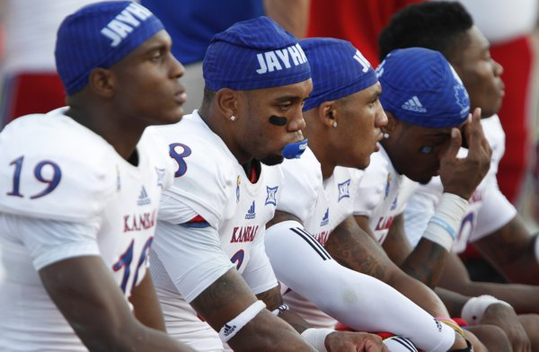 A somber bench of Kansas receivers including Nick Harwell (8) lament the 41-3 loss to Duke with minutes remaining during the fourth quarter on Saturday, Sept. 13, 2013 at Wallace Wade Stadium in Durham, North Carolina.