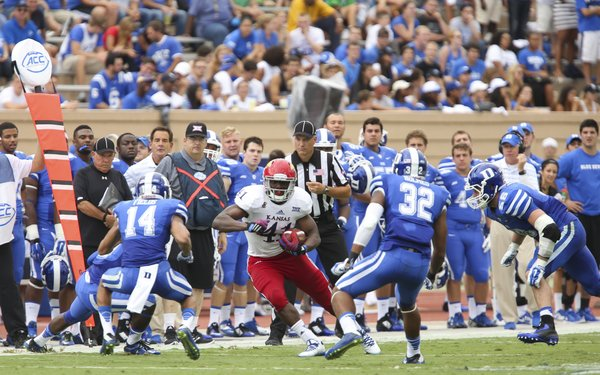 Kansas tight end Jimmay Mundine has nowhere to go as he is surrounded by several Duke defenders during the second quarter on Saturday, Sept. 13, 2013 at Wallace Wade Stadium in Durham, North Carolina.