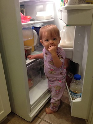 Lily, 11 months, caught with her hand in the vegetable drawer.