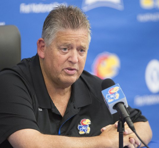 Kansas head football coach Charlie Weis answers questions from media members during a press conference  on Tuesday, Sept. 16, 2014 in Mrkonic Auditorium. Weis addressed preparations for the Jayhawks' upcoming home game against Central Michigan and also the play of quarterback Montell Cozart, which he hopes to be improved by this weekend.