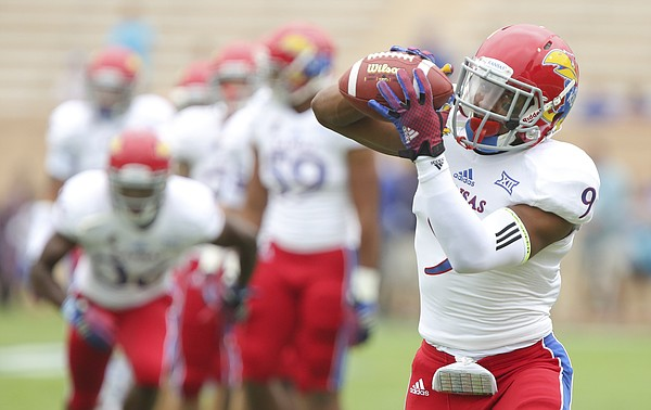 Kansas safety Fish Smithson catches a pass during warmups prior to the Jayhawks' kickoff against Duke on Saturday, Sept. 13, 2014, at Wallace Wade Stadium in Durham, North Carolina.