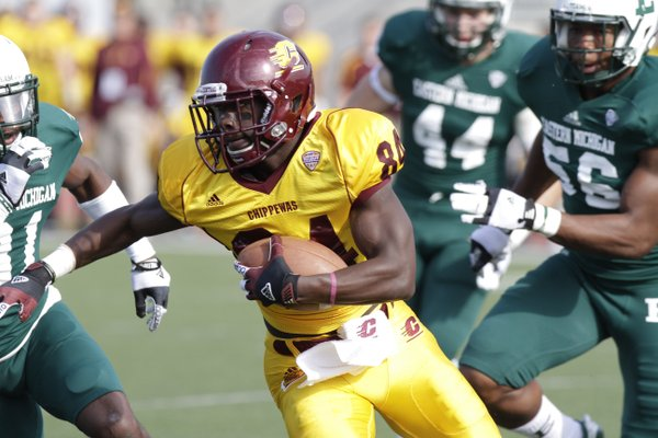 Central Michigan wide receiver Titus Davis (84) is pursued by , from left, Eastern Michigan defensive back Marcell Rose, linebacker Hunter Matt (44) and defensive lineman Andy Mulumba (56) in the first half of an NCAA college football game Saturday, Nov. 10, 2012, in Ypsilanti, Mich. (AP Photo/Duane Burleson)