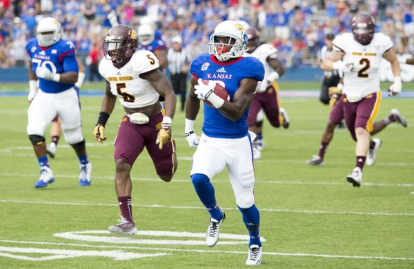 Kansas wasted no time getting on the board as senior Tony Pierson takes the ball 74 yards for a touchdown on the opening play from scrimmage during Kansas' game against Central Michigan on Saturday afternoon at Memorial Stadium.