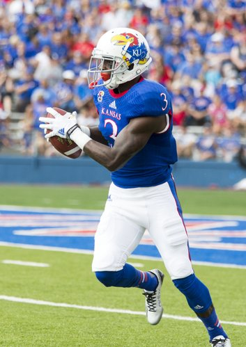 Kansas senior receiever Tony Pierson looks up field after making a catch in the flat during Kansas' game against Central Michigan on Saturday afternoon at Memorial Stadium.