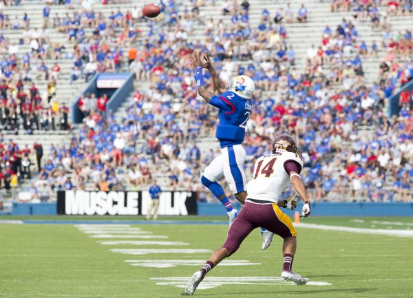 Quarterback turned receiver for a play, Kansas' Montell Cozart (2) leaps in front of Central Michigan defensive back Jason Wilson (14) for a reception on a half back pass during their game on Saturday afternoon at Memorial Stadium.