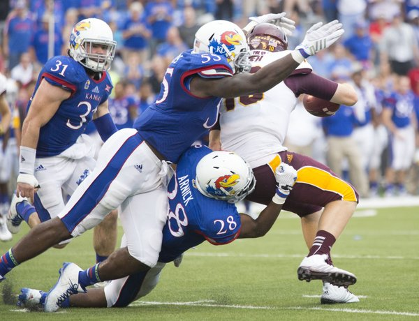 Kansas' Michael Reynolds (55) and Courtney Arnick (28) team up to sack Central Michigan quarterback Cooper Rush during the second half of their game Saturday afternoon at Memorial Stadium.