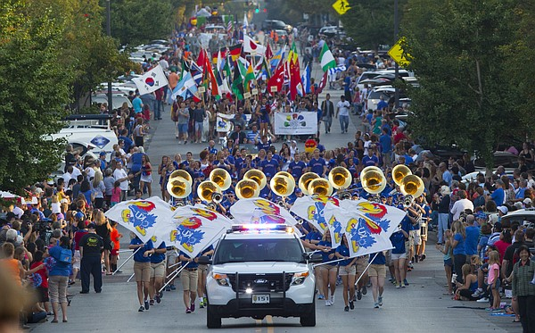 Spectators line the streets as the 2014 Kansas University Homecoming Parade marches north on Massachusetts Street, Friday, Sept. 26  2014 in downtown Lawrence.