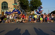 Members of the Kansas University cheer squad do backflips down Massachusetts Street during the 2014 Kansas University Homecoming Parade, Friday, Sept. 26  2014 in downtown Lawrence.