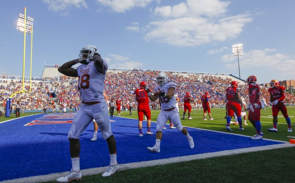 Texas quarterback Tyrone Swoopes celebrates after running in a touchdown against Kansas during the second quarter on Saturday, Sept. 27, 2014 at Memorial Stadium.