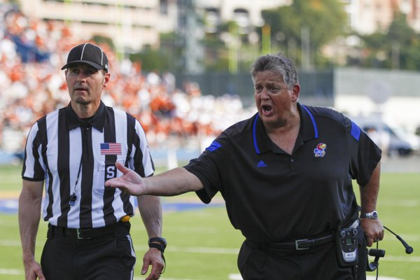Kansas head coach Charlie Weis lays into a game official for what he believes was a missed call during the second quarter on Saturday, Sept. 27, 2014 at Memorial Stadium.