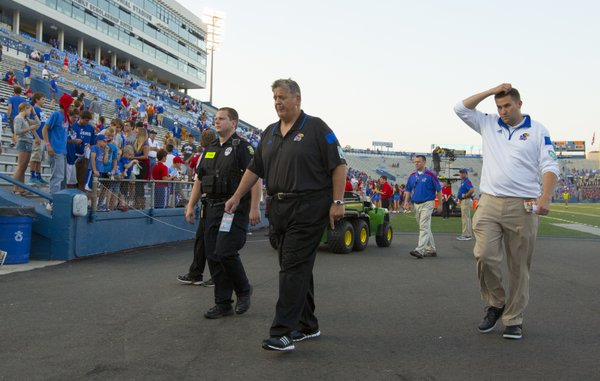 Kansas head coach Charlie Weis walks off the field following the Jayhawks' 23-0 loss to Texas on Saturday, Sept. 27, 2014 at Memorial Stadium.