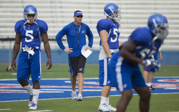 Kansas interim head football coach Clint Bowen watches over the defense during practice on Wednesday, Oct. 1, 2014.