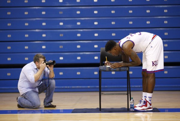 Kansas forward Jamari Traylor is photographed while filling out a humorous list of questions during Kansas basketball Media Day on Thursday, Oct. 1, 2014.