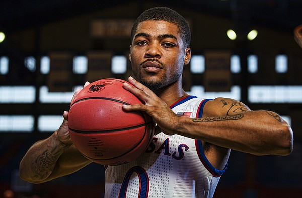 Sophomore guard Frank Mason poses for a photograph during the 2014 men's basketball media day at Allen Fieldhouse on Thursday, Oct. 2, 2014.