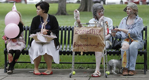 A park bench full of zombies wait for the start of the 8th annual Lawrence Zombie Walk Oct. 2, 2014.