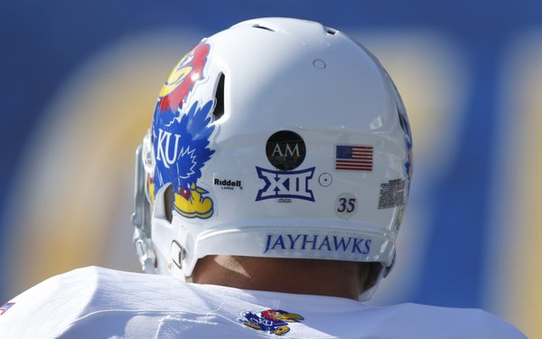 On the back of the Jayhawks' helmets are the initials AM to represent Andre Maloney, a Kansas recruit from Shawnee Mission West High School who died after suffering a stroke on the field on Oct. 4, 2013.