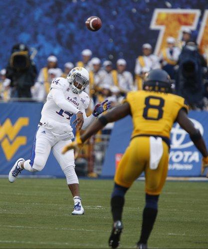 Kansas backup quarterback Michael Cummings throws to a target against West Virginia during the third quarter on Saturday, Oct. 4, 2014 at Milan Puskar Stadium in Morgantown, West Virginia.