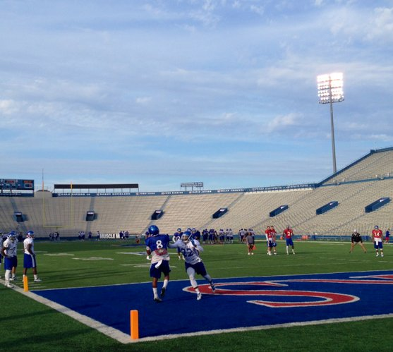 KU receiver Nick Harwell and defensive back Greg Allen battle for a ball during Wednesday's one-on-ones.