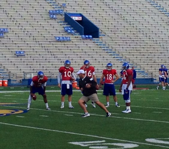 KU quarterbacks coach Ron Powlus works with the Kansas quarterbacks during Wednesday's practice.