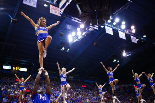 Members of the Kansas University cheer squad perform as the opening act during Late Night in the Phog on Friday, Oct. 10, 2014 at Allen Fieldhouse.