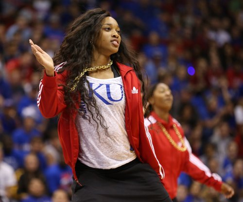 Caelynn Manning-Allen dances with her teammates during Late Night in the Phog on Friday, Oct. 10, 2014 at Allen Fieldhouse.