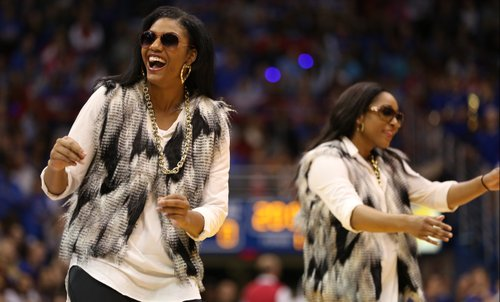 Jada Brown, left, laughs as she performs with teammate Natalie Knight during Late Night in the Phog on Friday, Oct. 10, 2014 at Allen Fieldhouse.