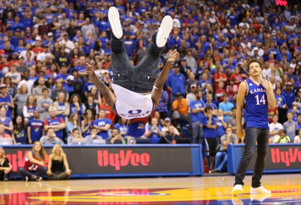 Kansas sophomore guard Frank Mason flips before ethe fieldhouse crowd during Late Night in the Phog on Friday, Oct. 10, 2014.