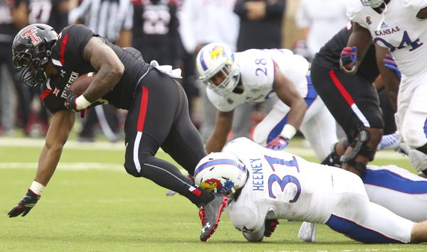 Kansas linebacker Ben Heeney drags down a Texas Tech receiver during the first quarter on Saturday, Oct. 18, 2014 at Jones AT&T Stadium in Lubbock, Texas.