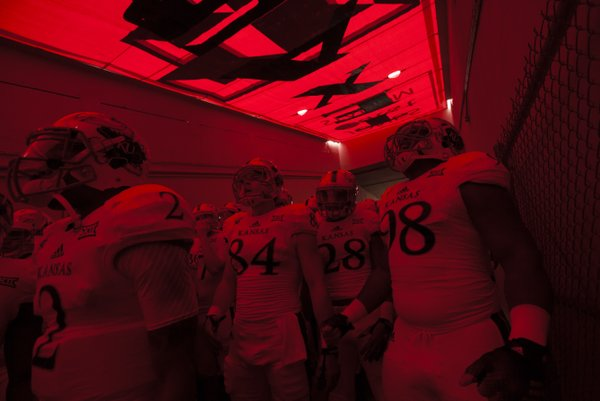 The Kansas Jayhawks get fired up in the tunnel prior to kickoff against Texas Tech on Saturday, Oct. 18, 2014 at Jones AT&T Stadium in Lubbock, Texas.