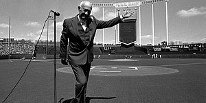 Kansas City Royals owner Ewing Kauffman waves to the crowd before the start of game 3 of the 1985 American League Championship Series. The Royals defeated the Toronto Blue Jays 4 games to 3 to advance KC to the World Series against the St. Louis Cardinals.