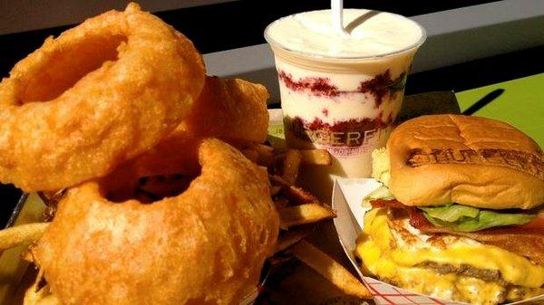 A meal from BurgerFi, featuring the restaurant's hand-dipped, freshly prepared onion rings.  Photo courtesy Charlie Guzzetta/BurgerFi