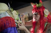 Liberty Hollis applies latex and paint to a mask for a Foxy by Proxy show. Members piece together outfits from new and used clothes as well as create their own eclectic outfits.