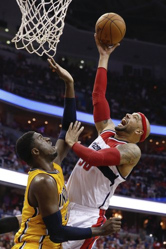 Washington Wizards forward Drew Gooden , right, shoots past Indiana Pacers center Roy Hibbert during the first half of Game 4 of an Eastern Conference semifinal NBA basketball playoff game in Washington, Sunday, May 11, 2014. (AP Photo/Alex Brandon)