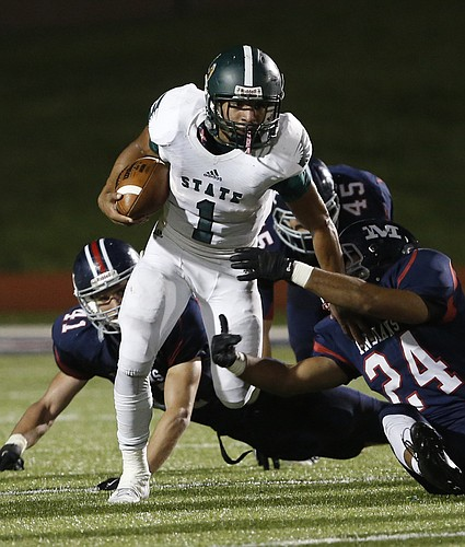 Free State junior Bryce Torneden runs against Manhattan on Oct. 24, 2014, at Manhattan.
