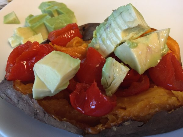 "A ""baked"" sweet potato made in the slow cooker and topped with peppadew peppers and avocado."