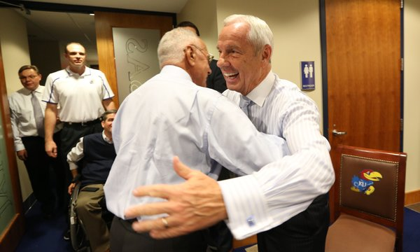 Former Kansas coaches Roy Williams and Larry Brown hug as they greet each other prior to the 60th Anniversary celebration of Allen Fieldhouse on Monday, Oct. 27, 2014.