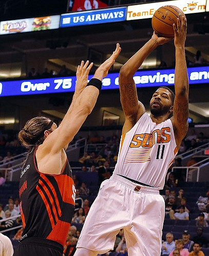 Phoenix Suns forward Markieff Morris (11) shoots over Flamengo forward Walter Herrmann (1) of Argentina, in the second quarter during an NBA preseason basketball game, Wednesday, Oct. 8, 2014, in Phoenix. (AP Photo/Rick Scuteri)