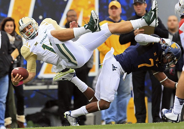 Baylor quarterback Bryce Petty is upended by West Virginia's Daryl Worley (7) in this photo from Oct. 18, 2014, in Morgantown, West Virginia.