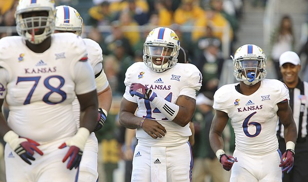 Kansas quarterback Michael Cummings shows his frustration after losing a fumble to Baylor during the third quarter at McLane Stadium on Saturday, Nov. 1, 2014 in Waco, Texas.