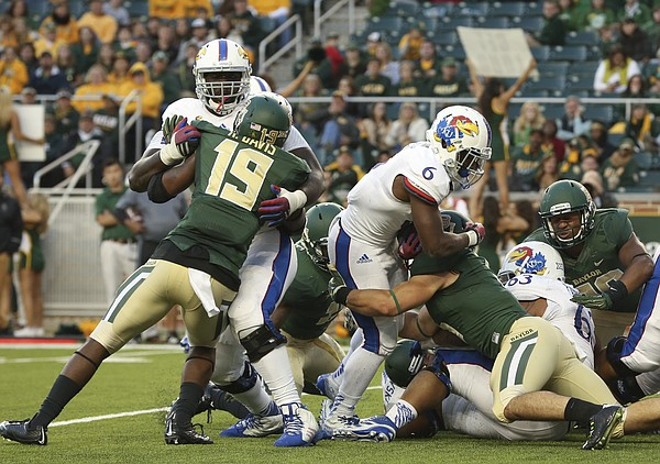 Kansas running back Corey Avery is stopped short on a fourth down attempt by the Baylor defense during the fourth quarter at McLane Stadium on Saturday, Nov. 1, 2014 in Waco, Texas.