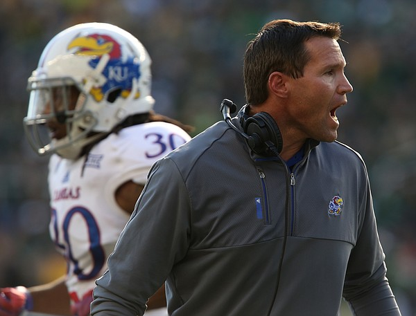 Kansas head coach Clint Bowen tries to keep his defense fired up after a Baylor score during the second quarter at McLane Stadium on Saturday, Nov. 1, 2014 in Waco, Texas.