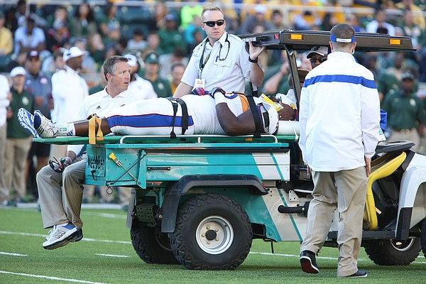 Kansas defensive lineman Keon Stowers leaves the field on a cart after being injured during the second quarter at McLane Stadium on Saturday, Nov. 1, 2014 in Waco, Texas.